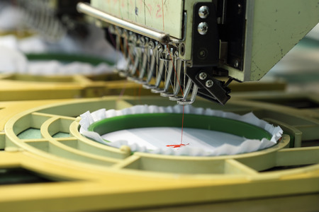 closed-up of Machine embroidery is an embroidery process whereby a sewing machine Stock Photo