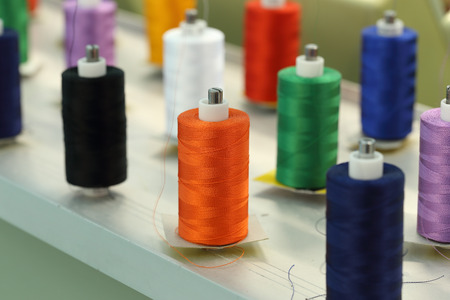reels of thread on Machine embroider Stock Photo