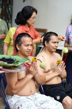 make belief: NAKHON RATCHASIMA, THAILAND-APRIL 12: Male who will be monk cut hair for be Ordained to new monk on April 12, 2015 in the Chae Temple,Nakhon Ratchasima,Thailand