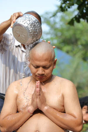 make belief: Male who will be monk shaving hair for be Ordained to new monk Stock Photo