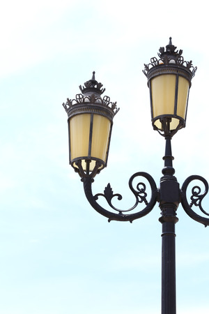 Antique lamp post with a sky background photo