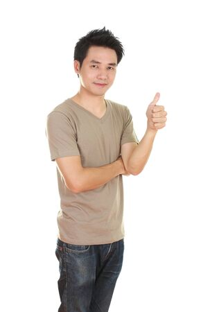man in blank brown t-shirt with thumbs up isolated on white background photo