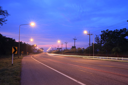 road with light pole at the night Banco de Imagens