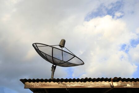 airwaves: Satellite dish with blue sky and cloud background