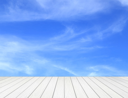 blue grunge background: white wood terrace with cloud and sky Stock Photo