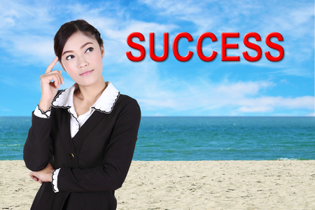 aha: business woman thinking about success with sea beach and sky background