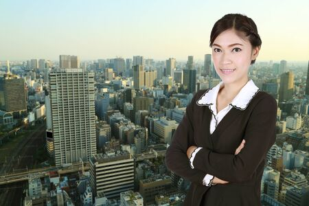 china people: Business woman , crossed arms, with city background