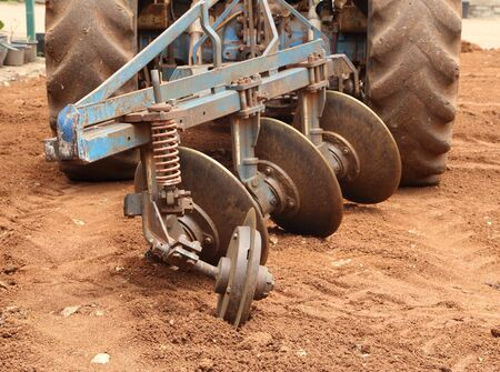 red soil: Close-up Tractor plow on red  soil, Thailand Stock Photo