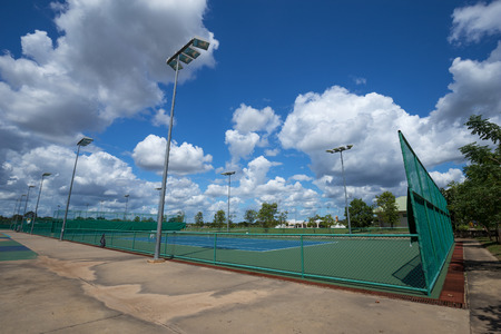 tennis court: outdoor empty tennis court with blue sky and cloud Stock Photo
