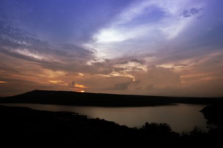 ratchasima: Silhouette of Lam Takong reservoir dam with mountain, Nakhon Ratchasima, Thailand