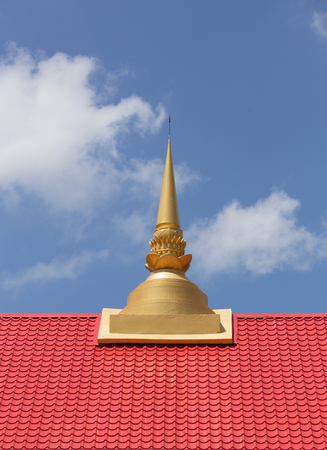 buddhist temple roof: Thai temple roof with small buddhist pagoda Stock Photo