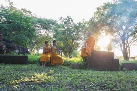 ratchasima: NAKORN RATCHASIMA - SEP 19: Unidentified Thai monks in the garden at Phanomwan Historical Park on September 19, 2015 in Nakhon Ratchasima, Thailand
