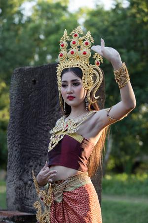 ratchasima: NAKORN RATCHASIMA - SEP 19: Unidentified woman with Thai dress at Phanomwan Historical Park on September 19, 2015 in Nakhon Ratchasima, Thailand