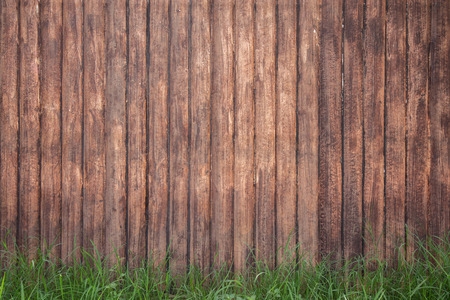 brown wood fence background with green grass Stock Photo