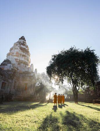 ratchasima: Unidentified Thai monks walking with sunlight at Phanomwan Historical Park in Nakhon Ratchasima, Thailand