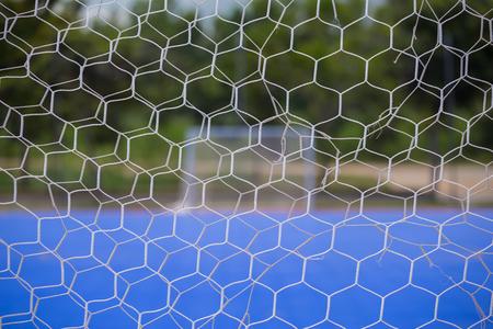 futsal: Goal net with blurred of futsal court background