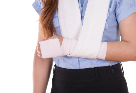 close-up injured arm wrapped in an Elastic Bandage isolated on white background Banco de Imagens