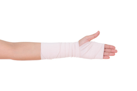 human's elbow: close-up injured arm wrapped in an Elastic Bandage isolated on white background Stock Photo