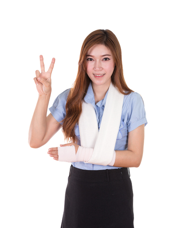 woman with an injured arm wrapped in an Elastic Bandage (victory sign) isolated on white background