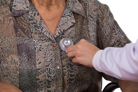 pacientes: close-up doctor listening to elderly patients heart Foto de archivo