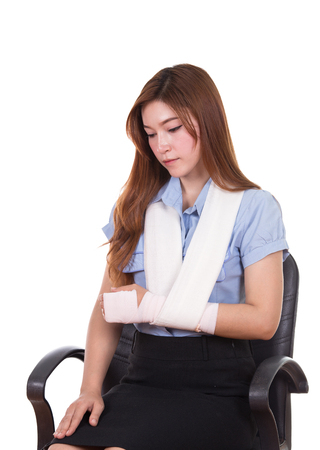 woman with an injured arm wrapped in an Elastic Bandage isolated on white background 스톡 콘텐츠