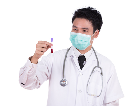 test glass: doctor in mask research a medical test glass with blood isolated on white background