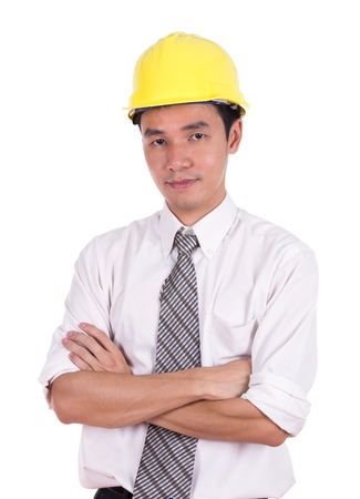 yellow helmet: engineer in yellow helmet with arms crossed, isolated on white