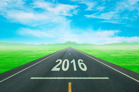 upcoming: Driving on an empty road to upcoming 2016 new year
