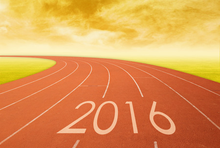 0 1 year: 2016 on red racing track with grass at sunset. 2016 new year concept