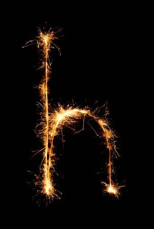 sign h: Sparkler firework light alphabet h (Small Letters) at night background