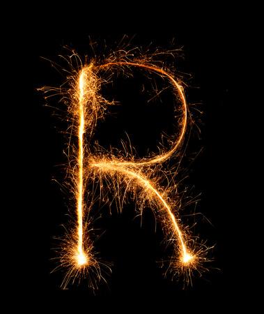 letter word: Sparkler firework light alphabet R (Capital Letters) at night background