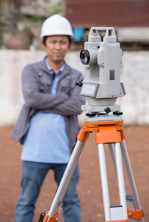 tacheometer: Surveyor equipment tacheometer or theodolite outdoors with engineer