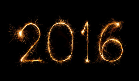 0 1 year: Happy new year 2016 written with Sparkle firework Stock Photo
