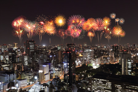 yeloow: Fireworks celebrating over Tokyo cityscape at night, Japan