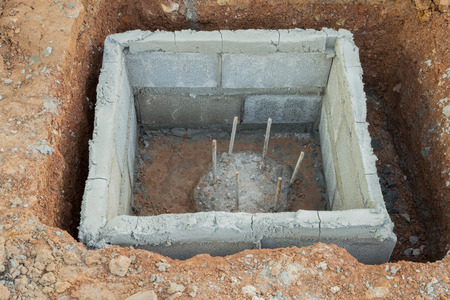 cement pole: hole of pole in construction site building prepare for pouring cement Stock Photo