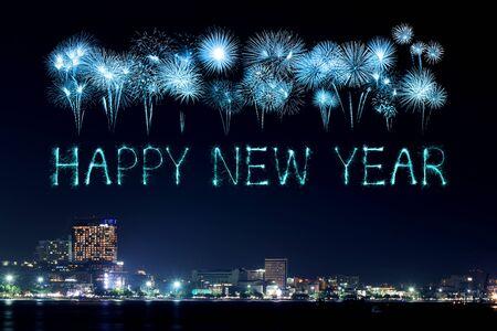 beach happy new year: Happy New Year Fireworks celebrating over Pattaya beach at night, Thailand Stock Photo