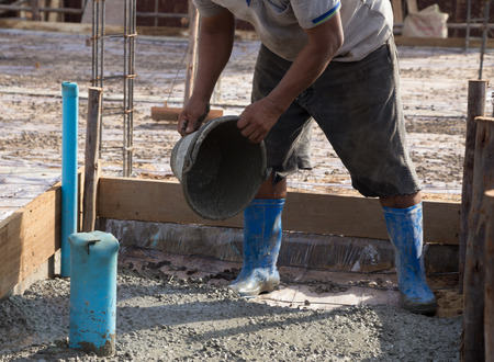 concreting: Concrete pouring during commercial concreting floors of buildings in construction Stock Photo