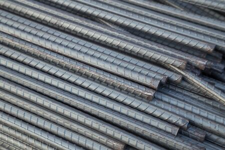 reinforcing bar: Steel rods or bars used to reinforce concrete for construction