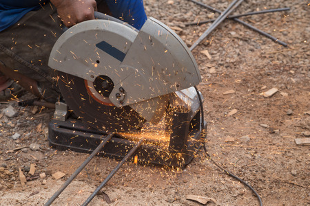cutting metal: Cutting metal with grinder. Sparks while grinding iron