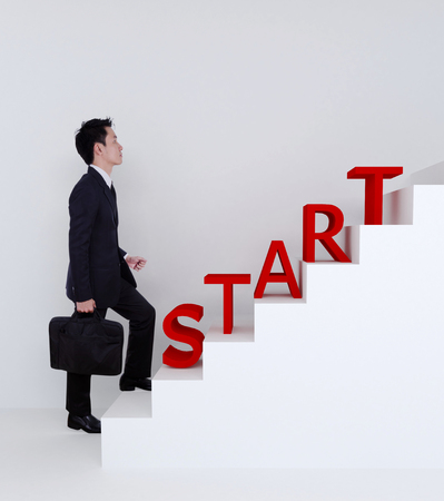 stepping: Business man start stepping up on stairs to success of bussiness Stock Photo