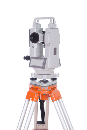 tacheometer: Survey equipment theodolite on a tripod. Isolated on white background