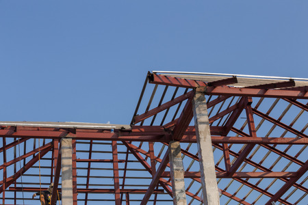 roof beam: structural steel beam on roof of building residential construction with sky Stock Photo