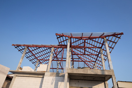 steel beam: structural steel beam on roof of building residential construction with sky Editorial