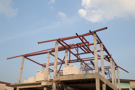 roof beam: structural steel beam on roof of building residential construction with sky Editorial