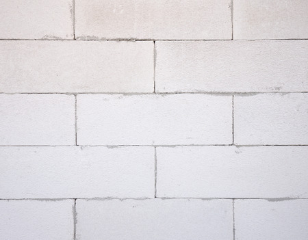 aerated: background texture of white Lightweight Concrete block, Foamed concrete block, raw material for industrial wall or house wall