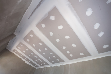 gypsum board ceiling of house at construction site Banco de Imagens