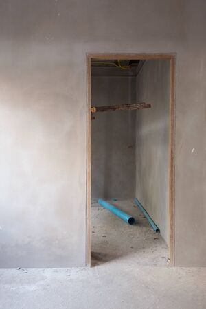 housebuilding: structural door and wall in residential building construction site