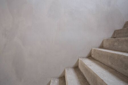 housebuilding: staircase cement concrete structure with wall blank for text