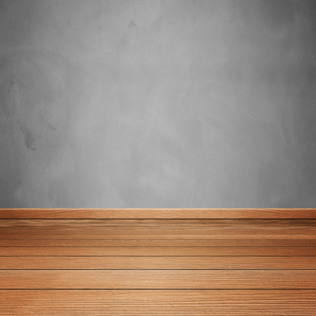 on wood floor: empty room interior with concrete wall and brown wood floor Stock Photo