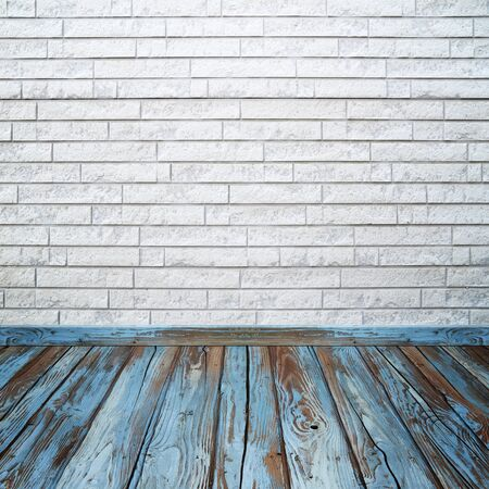 brick floor: empty room interior with brick wall and wood floor Stock Photo